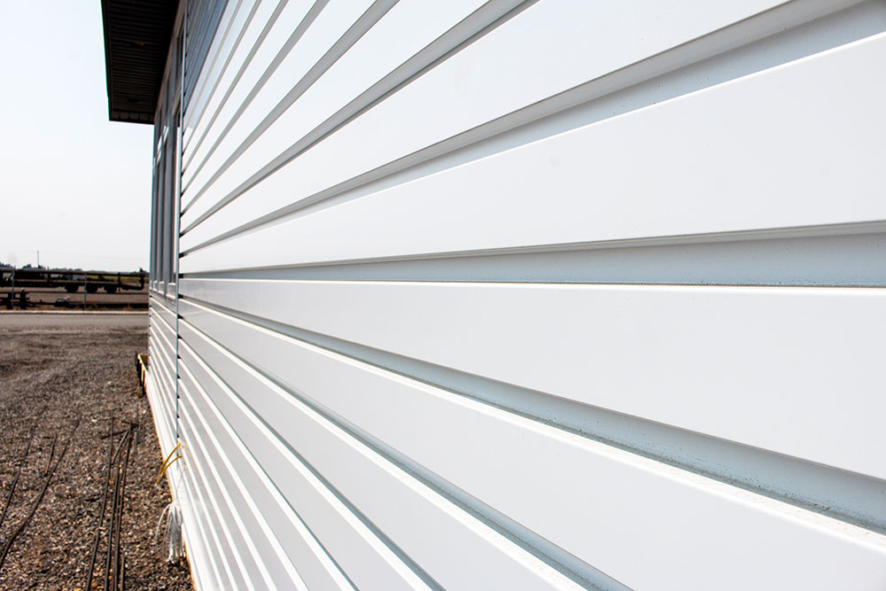 Commercial Office with Custom Panel Siding in Bright White
