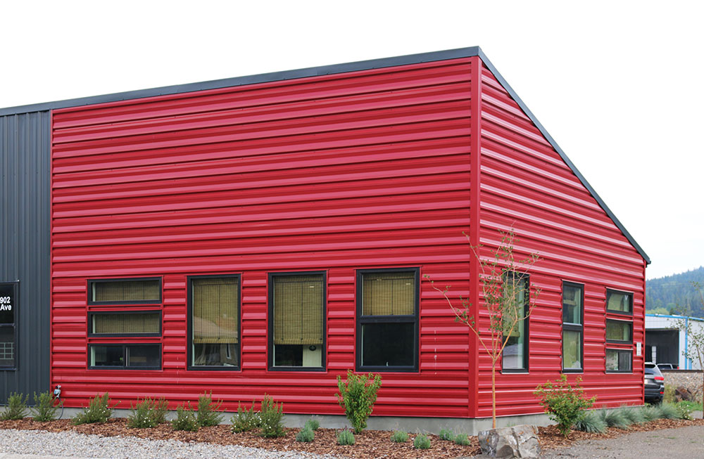 Commercial Distribution Centre featuring FA Panel Siding in Dark Red