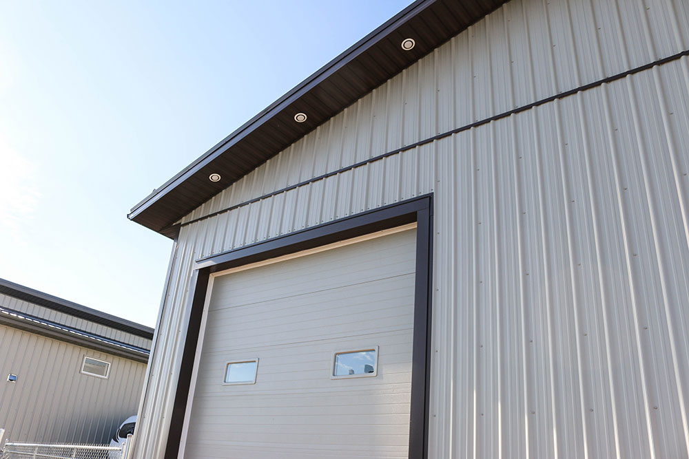 Commercial Shop featuring FC-36 Siding in Stone Grey and Dark Brown Trim & Soffit