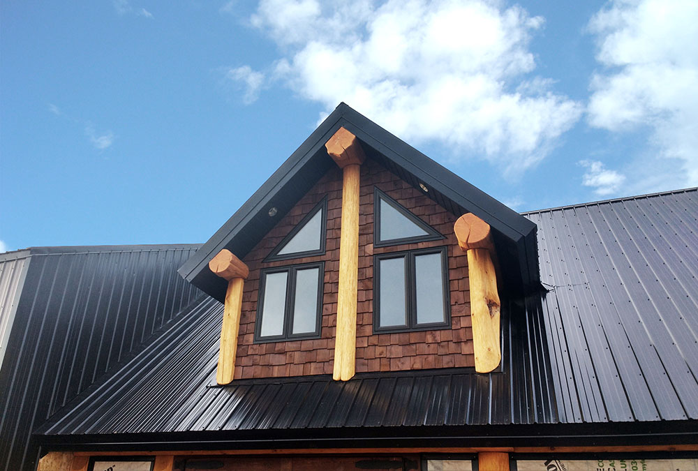 Residential Roof on Log Cabin featuring the FC-36 Panel in Black