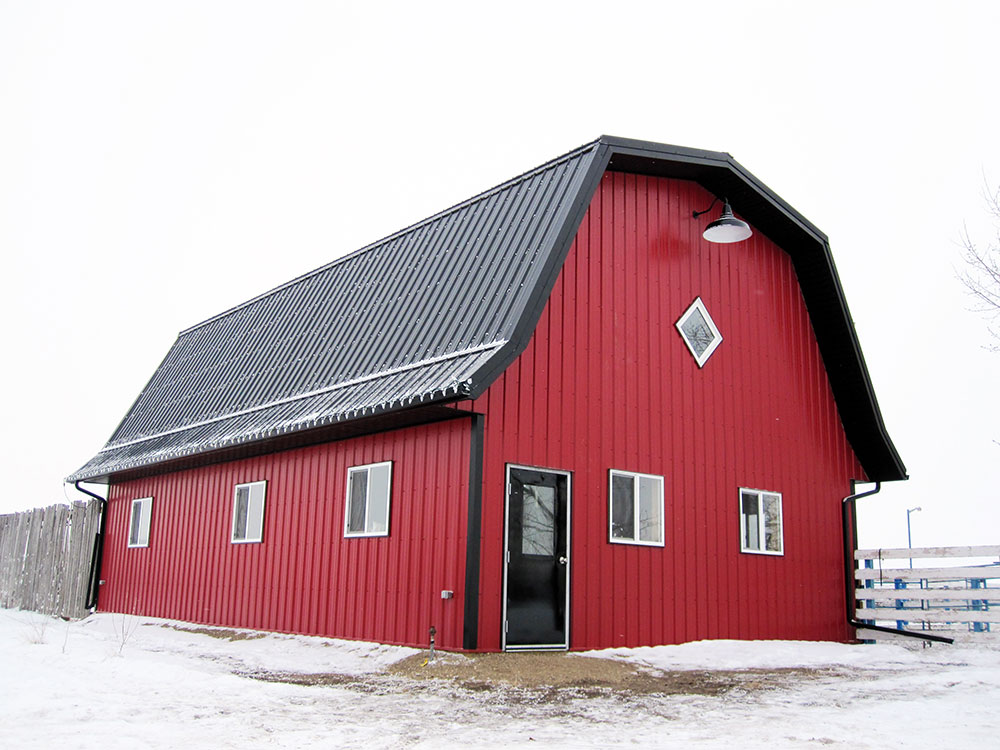 Agricultural Barn with FC-36 Panel Siding in Bright Red and FC-36 Panel Roof in Black
