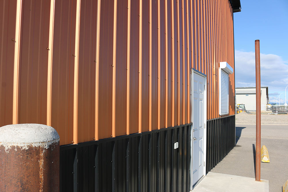 Commercial Shop featuring FC-36 Panel Siding in Copper Penny and Black