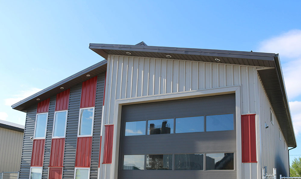 Commercial Shop with FC-36 Siding in Stone Grey & Tile Red with Charcoal Custom Panel Accent