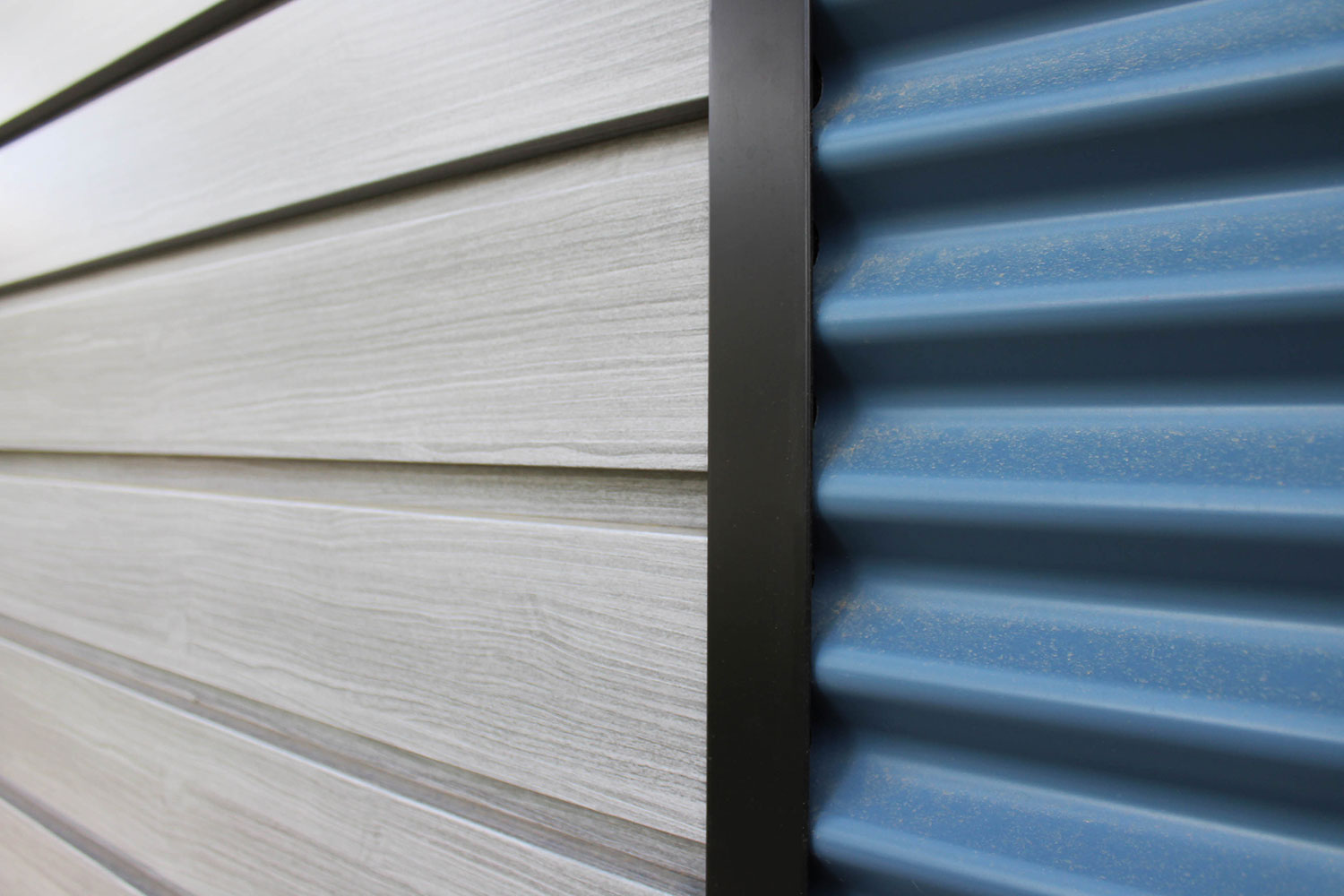 Residential Building with 7/8 Corrugated Oxford Blue Panel and Barnboard Woodgrain