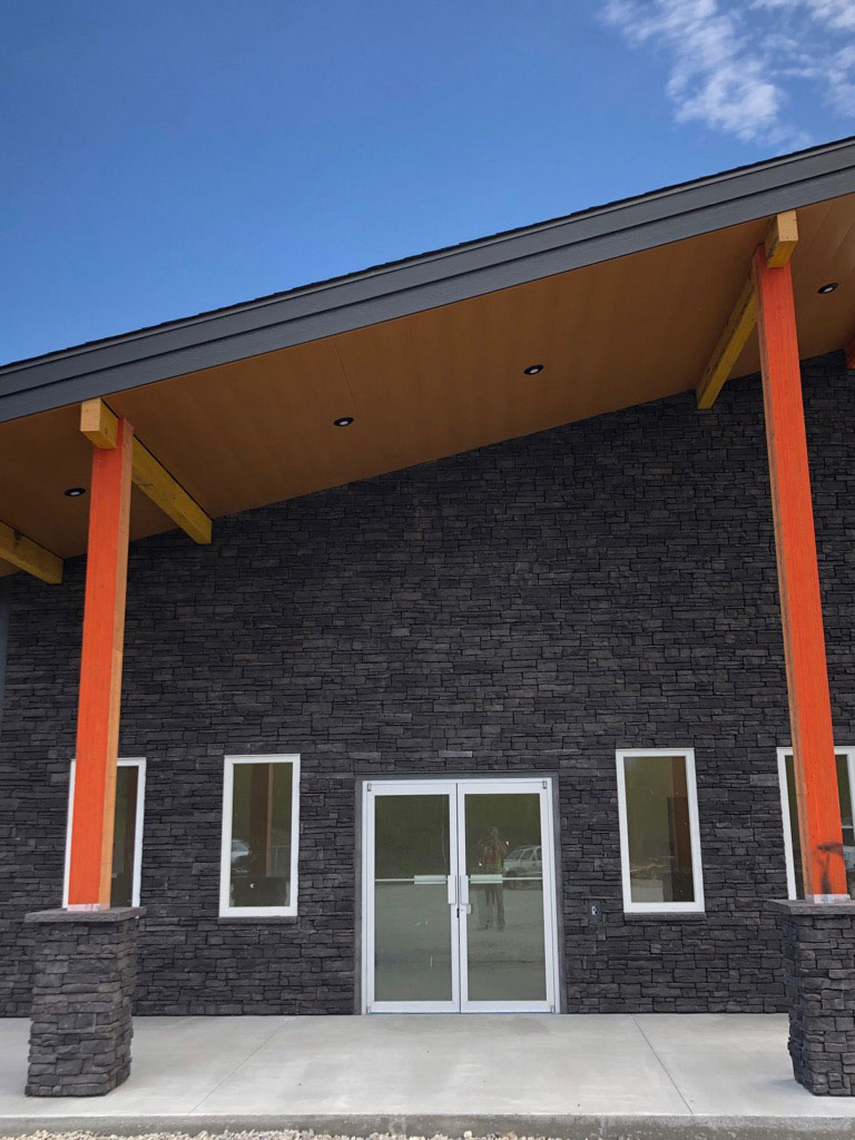 Commercial Building with Custom Folded Soffit Panels in Autumn Woodgrain