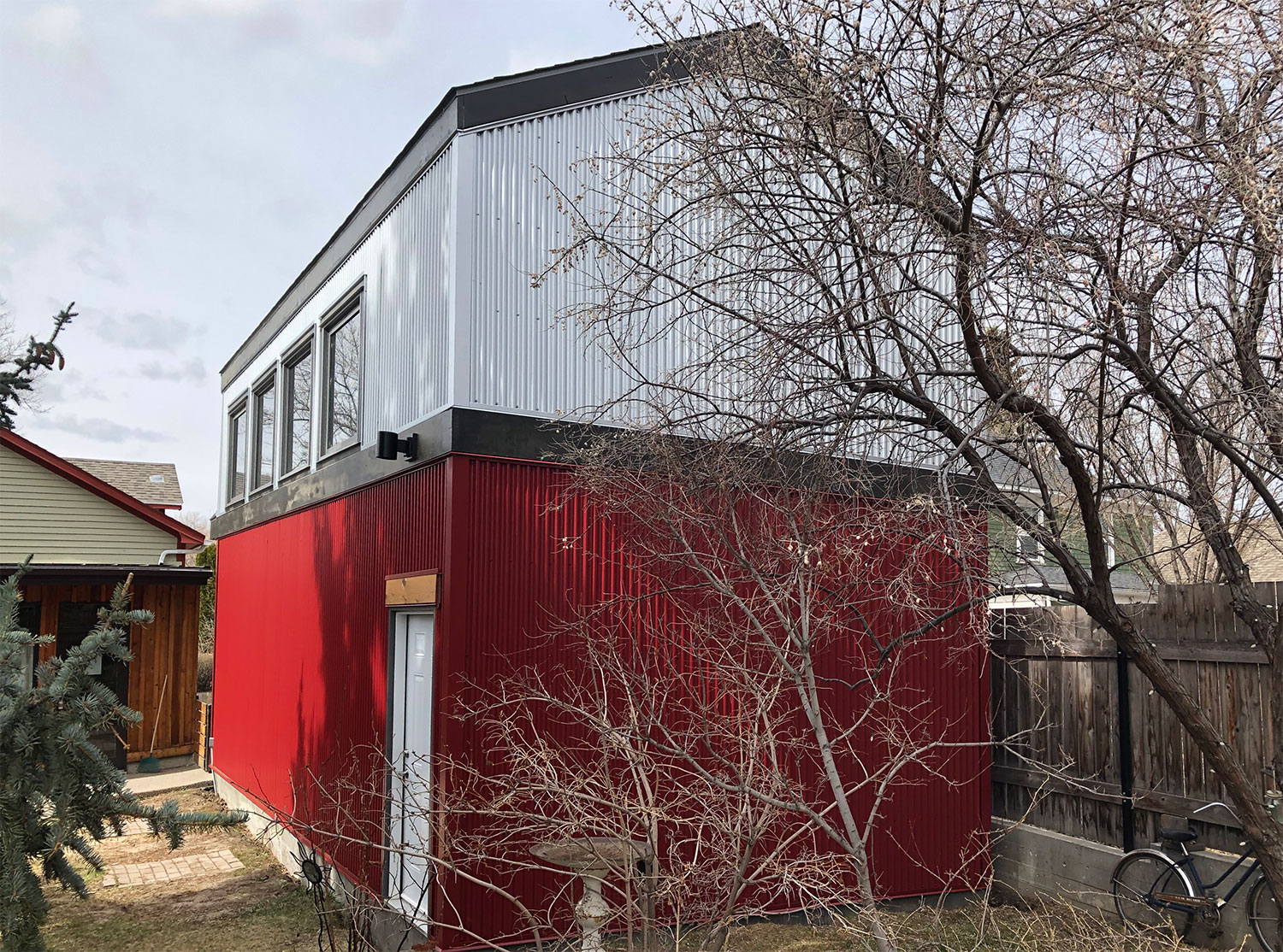Residential Garage with Corrugated Galvalume and Dark Red