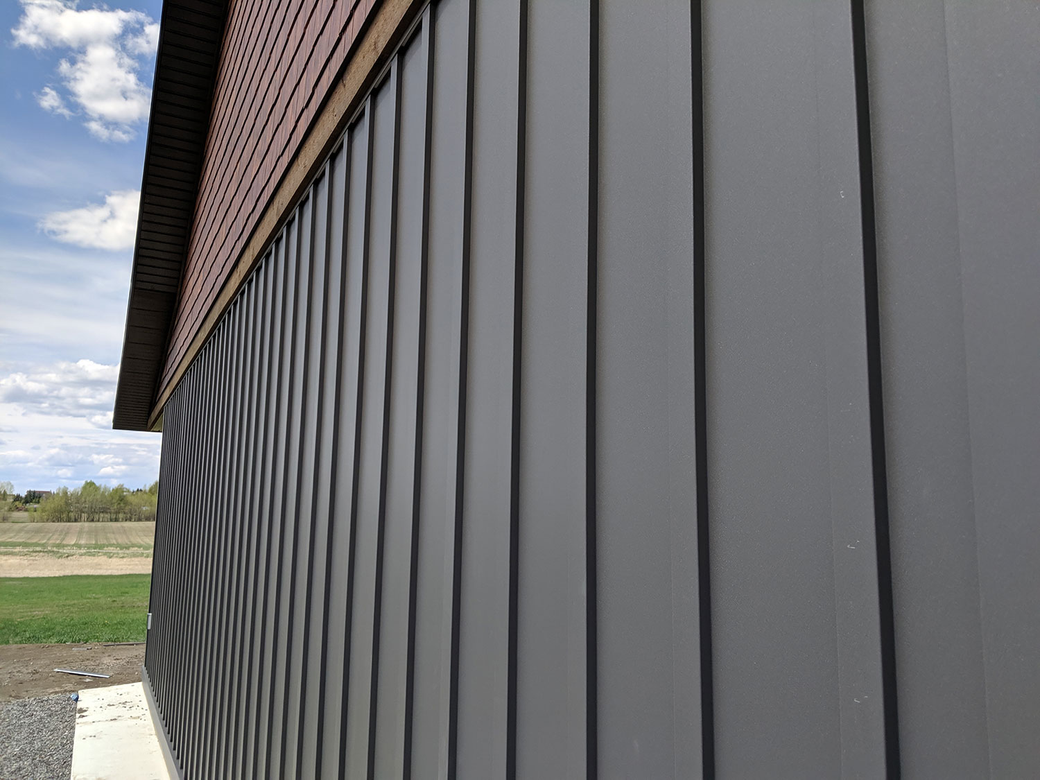 Residential Building with Custom Board and Batten Panels in Graphite FormaTouch Textured Steel