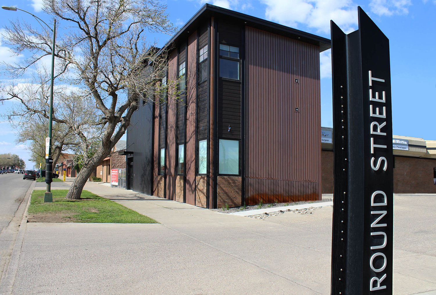 Residential Building with Custom Folded Weathering Steel Panel