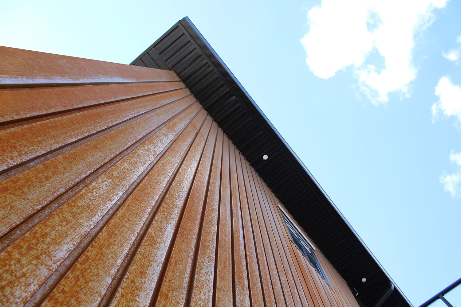 Residential Building with a Custom Folded Weathering Steel Panel
