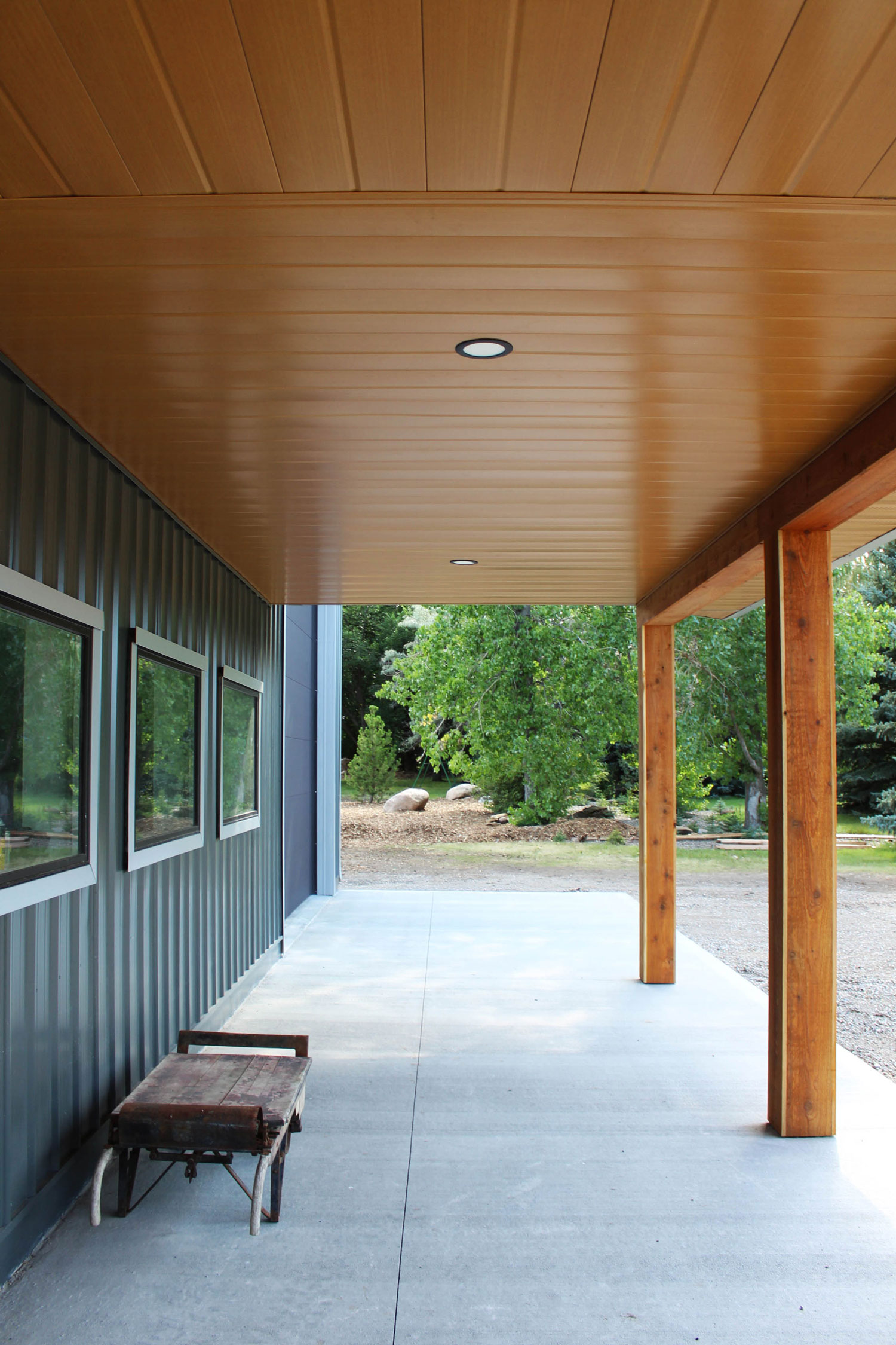 Gunmetal grey siding and Vented Soffit and non-vented soffit in Autumn Woodgrain on a residential work shop