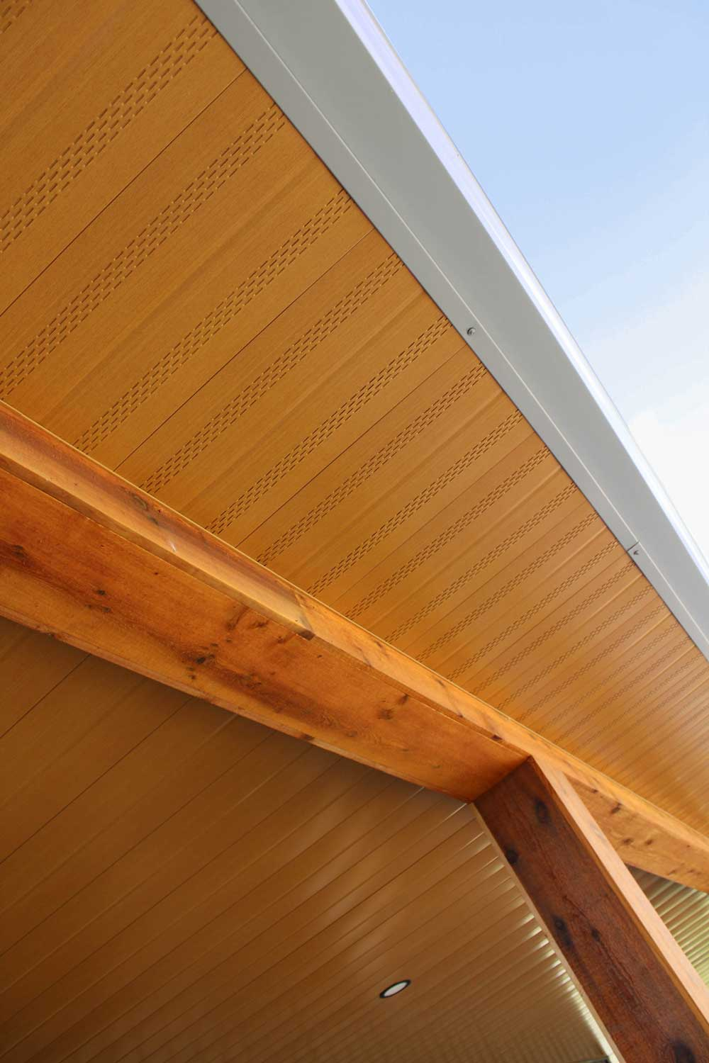 Vented Soffit and non-vented soffit in Autumn Woodgrain on a residential work shop